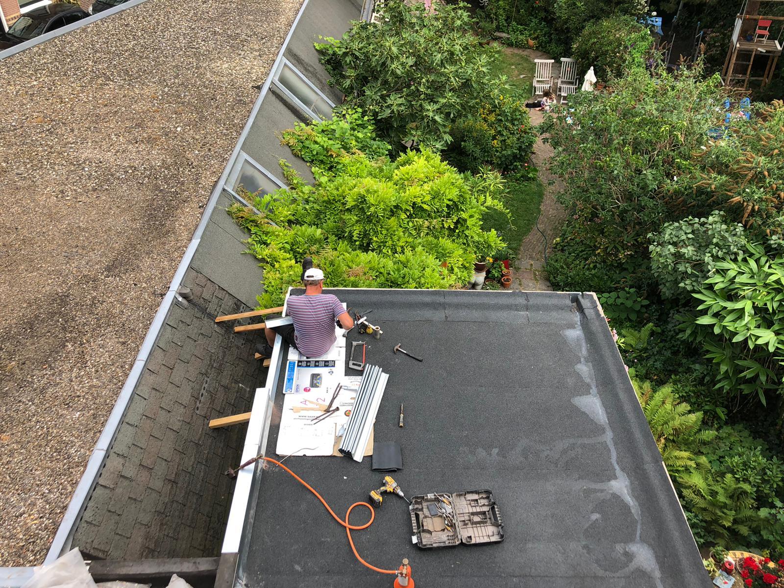 dakdekkers - afwerken pir met bitumen en zinken deklijsten